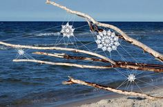 n Oak Beach, Polish outdoor artist NeSpoon introduced a little bit of street art to the beach bordering the Baltic Sea. The artist, who visits Oak Beach every summer, decided that it was time to incorporate some art into the landscape. So NeSpoon used pieces of driftwood as the foundation for these lace installations, which remind me of complicated cobwebs. There is an intricate and stunning beauty present in the repetitive patterns and amazing details of each creation.