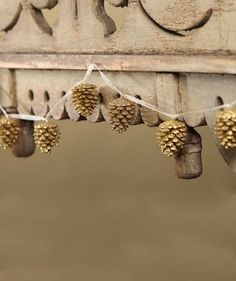 Gold Glittered Pinecone Garland from The Holiday Barn
