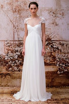 The illusion sleeves of this Monique Lhuillier Wedding dress are beautiful touch to this simple gown.