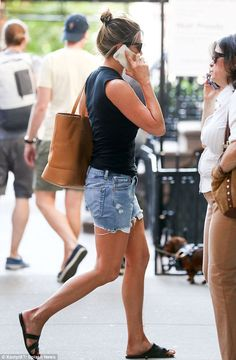 On her way: Jennifer was pictured heading out in New York wearing denim shorts and flat sa...