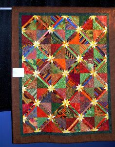 Quilt Show Time - Full picture of vibrant Hunter's Star quilt