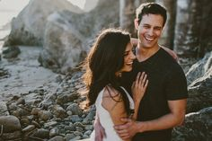We walked the cliffs before venturing downto the sand where we'd jump rocks and crawl throughcaves during this Beach Engagement Session near Los Angeles.