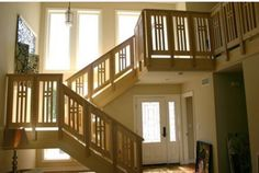 Craftsman/prairie design with ash wood stair railing by W. Steven Jones