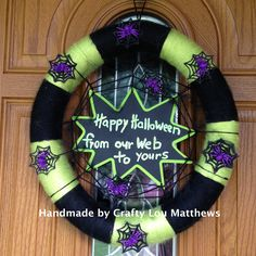 Happy Halloween wreath from our web to yours with purple sparkly spiders.