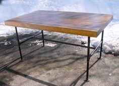 Wood pipe table made by Century Porch Post Inc.