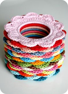 Use hair rubber bands to make these crocheted hair scrunchies. (No pattern, but you can make up your own.)