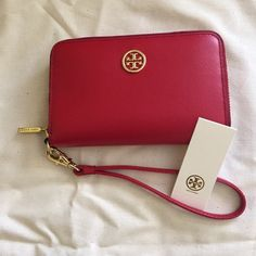Tory Burch Smartphone Wristlet/ Color: Kir Royale Tory burch Wristlet perfect for holding your smart phone and includes strap for easy transport. Comes in a Kir Royale Red. Tory Burch Bags Clutches & Wristlets
