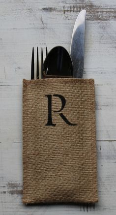 Our monogram burlap silverware pouch allows for a personalized touch. Inked in black for a bold statement, and easily paired with any color palette, these pouches make a true tabletop statement! Holde