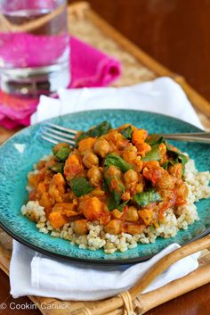 This slow cooker vegetarian curry recipe stars sweet potato and chickpeas, and is a fantastic choice for a Meatless Monday meal.