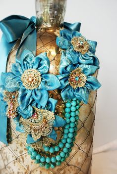 Turquoise silk and gold vintage jewels statement necklace.  $380.00 by Unjourdemoins  @ Etsy