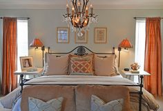 The ice-blue and terra-cotta master suite is an elegant collection of plush pillows, silk textiles and vintage accents. Janes replaced a ceiling fan with an antique chandelier over the bed.