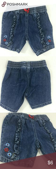 """First Moments Baby Girl's Denim Bottoms 3-6Mo EUC Excellent used condition, no noted flaws. Baby size 3-6 months. Color denim blue with red and light blue accents. Elastic waistband. Red bow at waist, and red/blue embroidered accents. Cute ruffled accents on front. 100% Cotton. Machine wash.   Approx. laying flat measurements: 8"""" waist, 10"""" long.   Remember to bundle up and save more, so check my closet for other treasure finds. first moments Bottoms Jeans"""