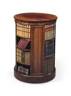 A GEORGE IV ROSEWOOD CIRCULAR BOOKCASE  BY GILLOWS, CIRCA 1820-30
