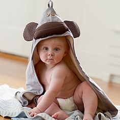 Baby with grey monkey hooded towel