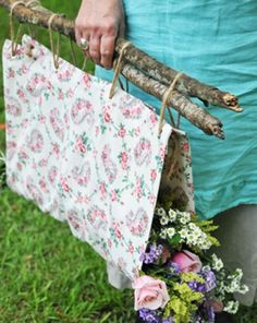 This is such a beautiful idea for gathering flowers. Use your favourite fabric and some found sticks.