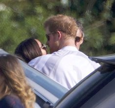 Passionate embrace … Meghan Markle locked lips with her boyfriend Prince Harry at the posh polo event over the weekend