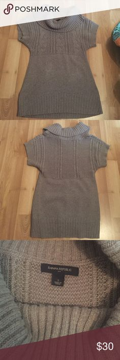 Banana republic short sleeve sweater. Gray short sleeve sweater in like new condition. Could be worn with jeans or as a dress. Perfect for fall to go with a cute pair of boots. 80% cotton 20% wool. Banana Republic Sweaters Cowl & Turtlenecks