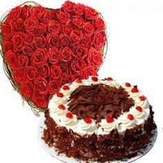 51 red heart shape arrangement and one pound black forest cake