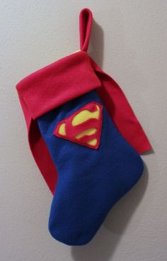 Holiday Superhero Stockings - These Comic Book Christmas Stockings are Festively Heroic (GALLERY) ~ This is great! Using a plush fabric or a good wool felt, it would not be too difficult to make. Christmas Sewing, Noel Christmas, All Things Christmas, Cowboy Christmas, Christmas Projects, Christmas Crafts, Christmas Decorations, Christmas Ornaments, Homemade Christmas