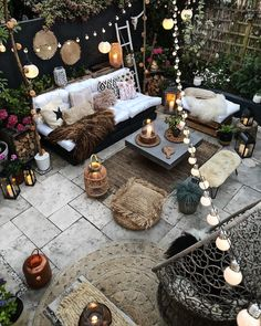 Our Favorite boho decor ideas for modern patio spaces and outdoor living! We love these furniture sets, outdoor rugs, plants and planters and lighting ideas Bohemian Patio, Bohemian Garden Ideas, Small Garden Room Ideas, Cosy Garden Ideas, Garden Lighting Ideas, Backyard Party Lighting, Patio Garden Ideas On A Budget, Boho Garden Party, Boho Dekor