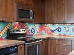 One-of-a-kind backsplash mosaics can be made of ceramic tile as well. Mosaic artist Vicki Morrow of Tile Art Mosaics in Scottsdale, Arizona, designed and fabricated this backsplash for clients who collect southwestern art. Kitchen Redo, Kitchen Tiles, Kitchen Colors, Design Blog, Küchen Design, Design Ideas, Mediterranean Kitchen Backsplash, Ceramic Tile Backsplash, Backsplash Ideas