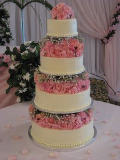 Graul's: Wedding cake separated by pink roses (Baltimore's best wedding cakes)