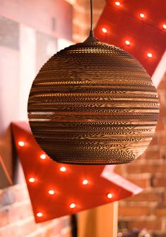 love these lights made from cardboard boxes.