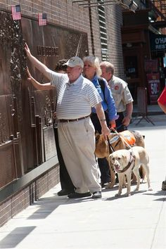 Michael Hingson, who is blind, is pictured at a 9/11 memorial wall 10 years after the terrorist attacks. His guide dog Roselle led him out of the WTC.