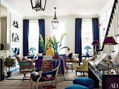 In the eclectic Manhattan living room that Jeffrey Bilhuber furnished for advertising executive Trey Laird, shapes and styles happily mingle. The comfortable rolled-arm sofa (its seat cushions are upholstered in a Brunschwig & Fils tiger-stripe velvet) joins Danish side chairs with firm button tufting, a low Victorian slipper chair, deep club chairs, a couple of ottomans (clad in a blue Muriel Brandolini fabric from Holland & Sherry), and a Louis XVI–style armchair.