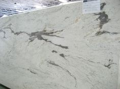 Kitchen counter top options that are similar to Carrera Marble!