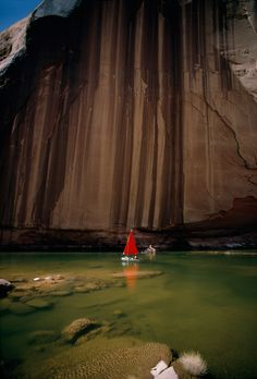 Iron and manganese seepage creates streaks on a sandstone wall on Lake Powell in Utah, July 1967.Photograph by Walter Meayers Edwards, National Geographic