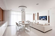 Check out the Mercury ceiling lamp by Artemide in this modern white apartment designed by Alexandra Fedorova