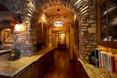 The kitchen's stone arches are incredible and invoke a true Tuscan feeling.