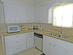 I wish I had more cabinet space & I like white cabinets & appliances! Kitchen has 18X18 tile floors.