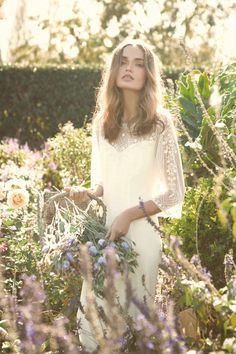 """Boho wedding dress with long flowing sleeves. Bo and Luca """"Saint George's"""" Bohemian Wedding Dresses. Strappy Wedding Dress, Luxury Wedding Dress, Tea Length Wedding Dress, Bohemian Wedding Dresses, Chic Wedding, Wedding Styles, Wedding Ideas, Bridal Gowns, Wedding Gowns"""