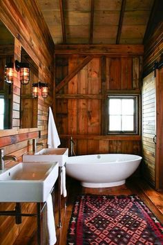 Trade in cabin kitsch in the bathroom for sleek, modern elements like a freestanding tub.