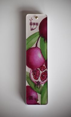 Pomegranates Mezuzah Case, This Mezuzah case is an image of ruby red pomegranates, one of the seven species mentioned in the Bible, that represent the land of Israel.