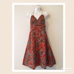"Moulinette Souers Anthropologie halter dress Adorable batik design halter dress with rope ties, side pockets and zips in back. 100% cotton and fully lined. Perfect condition. Length is 24.5"" from bottom of bodice to hemline  bust is 14"" across the front at top of bodice. Colors are turquoise, orange, red and black. Anthropologie Dresses"