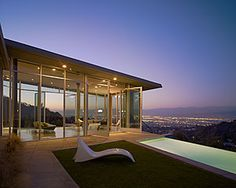 """crazy stupid love home - Jacob Palmer's (Ryan Gosling) ultra-modern and chic bachelor pad. This architectural wonder sits perilously on a cliff overlooking downtown LA and the San Fernando Valley and gives new meaning to """"living on the edge."""" The home features floor to ceiling glass throughout the entire residence, a guest house, an infinity pool, stainless steel appliances and a view that would make any A-List celeb swoon. (Photo Credit: Architectural Record)"""