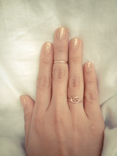 Glittery nails & love the rings