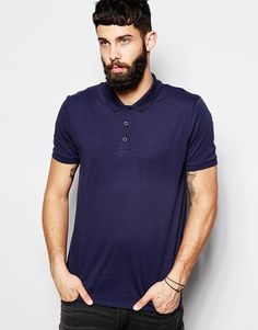 "Polo shirt by ASOS Soft-touch jersey Point collar Three button placket Fitted cuffs Regular fit - true to size Machine wash 100% Cotton Our model wears a size Medium and is 181cm/5'11"" tall"