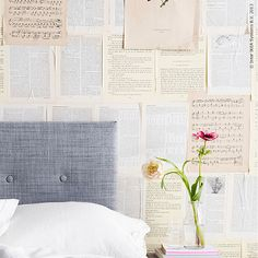 a wall of old book pages