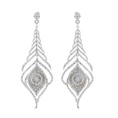 Round-cut white diamonds cover these feather design sterling silver earrings. These earrings offer a highly polished shine and attach with butterfly clasps. White Diamonds Diamonds: 104 Diamond cut: R