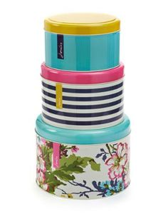 Joules Set of 3 Large Cake Tins, Multi.                     Good tins come in threes! Keep your baked goods away from sticky fingers in style with this set of stacking tins. Each is adorned with an exclusive print.
