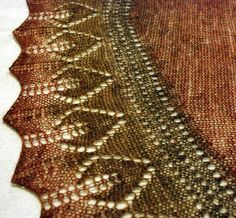 Free Knitting Pattern for Labor Day Shawl - Crescent shaped shawl worked from the bottom shaped lace edge up through and eyelet section and stockinette body. Designed by O/C Knitiot Designs – Deby Lake. Great with multi-colored yarn! Pictured project by gis