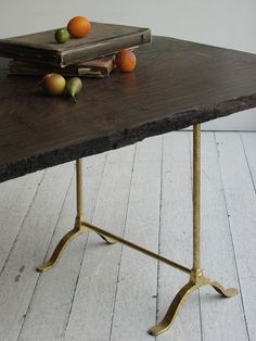wood table with brass base