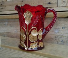 Hey, I found this really awesome Etsy listing at https://www.etsy.com/listing/231130525/ruby-red-inverted-thistle-juice-pitcher