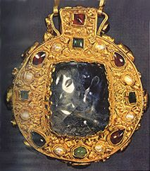The Sapphire Talisman of Charlemagne,  c. 768-814. Two large cabochon sapphires - one oval, one square - enclose holy relics (what are supposed to be a remnant of the Holy Cross and a small piece of the Virgin's hair, visible only when looking through the oval sapphire at the front of the medallion.) The other gemstones are garnets, emeralds, and pearls.