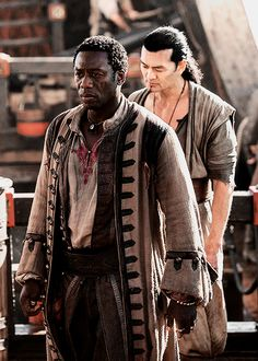 Mr. Scott and Joji - Hakeem Kae-Kazim and Winston Chong in Black Sails (TV series 2014-).
