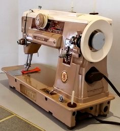 The is a slant-o-matic and you can see how the needle bar slants to bring your work right out in front of you for great visibility of your project. I Need A Hobby, Antique Sewing Machines, Old Singers, Dream Machine, Sewing Table, Vintage Japanese, Dressmaking, Retro Vintage, Restoration